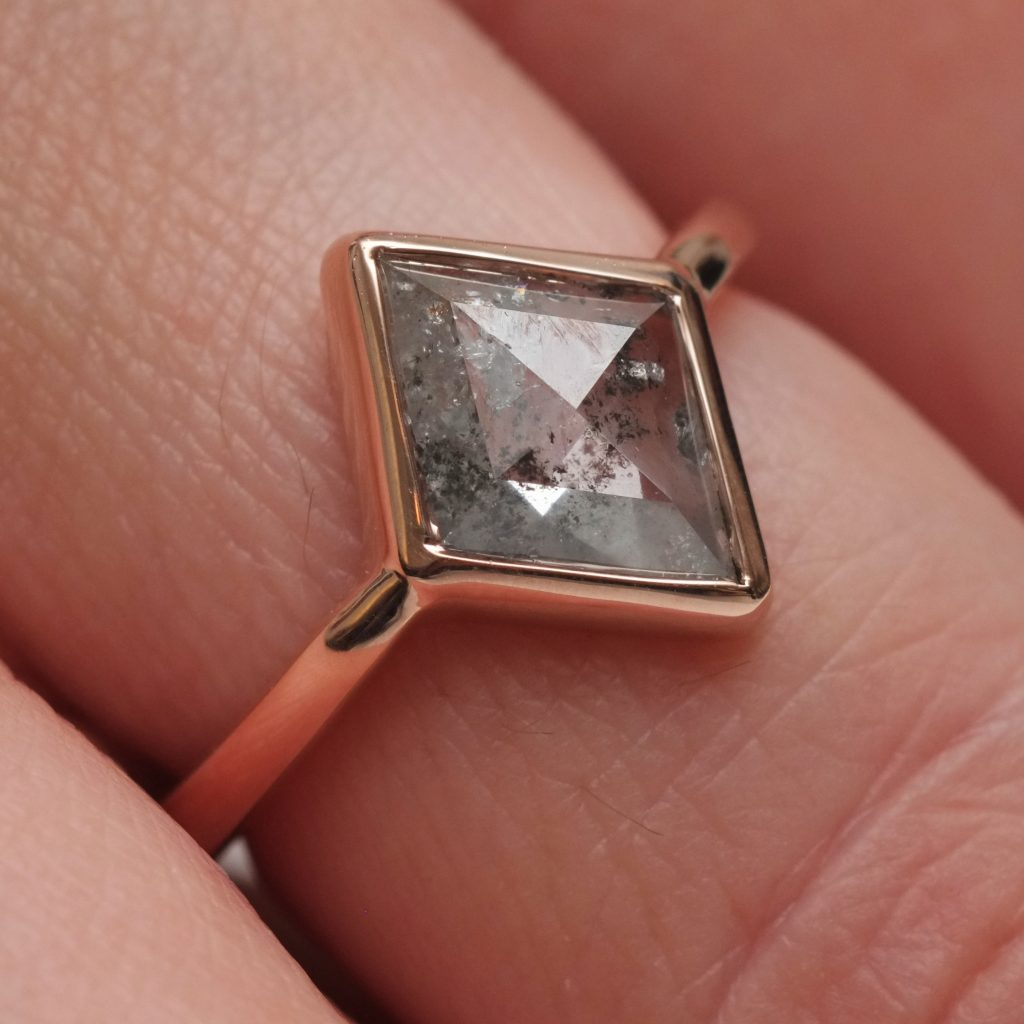 Kite shaped salt and pepper engagement ring