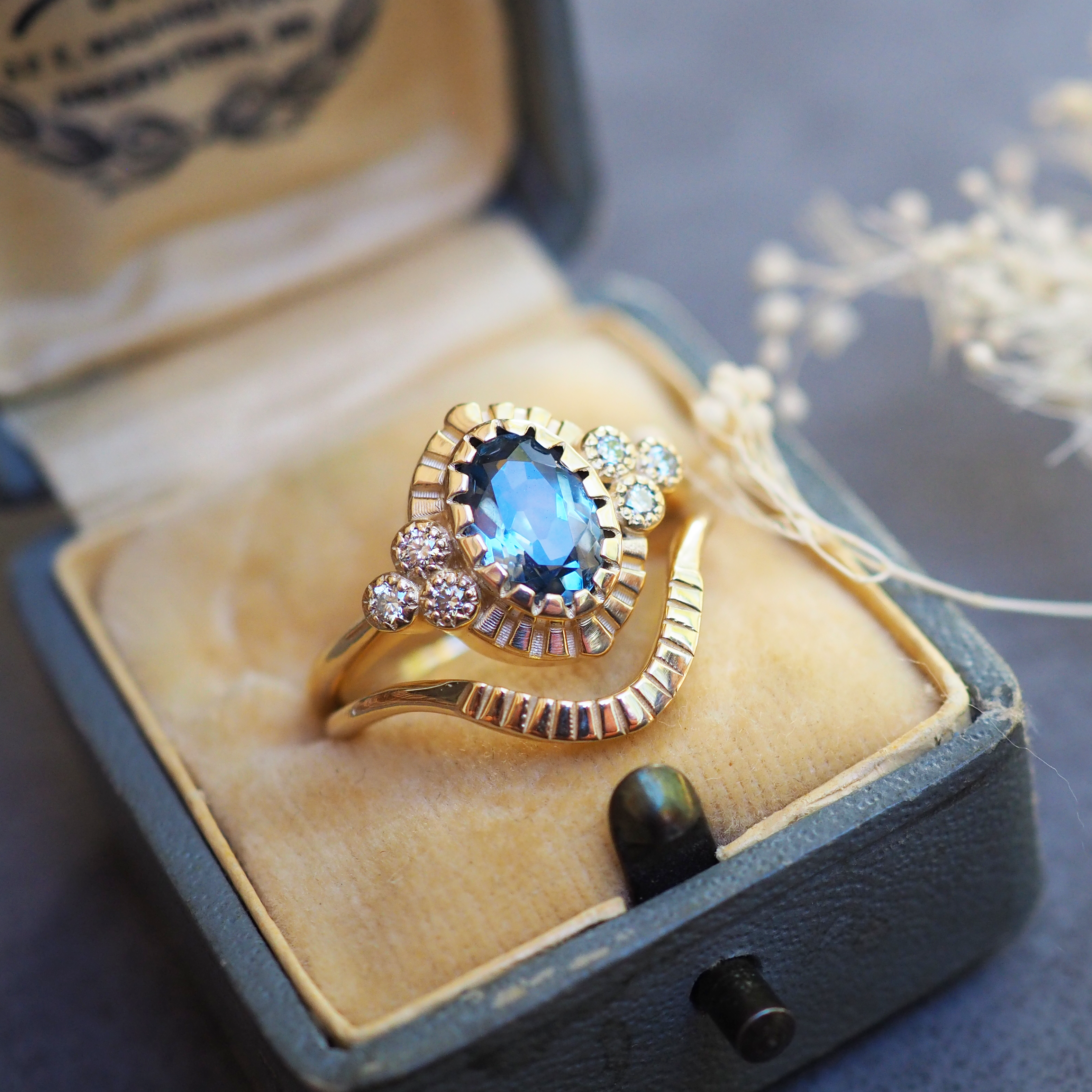 Teal Sapphire and Diamond Engagement Ring